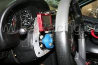 mounts behind steering wheel